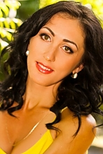 Ukrainian girl Natali,25 years old with brown eyes and black hair.