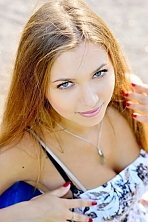 Ukrainian girl Viktoriya,20 years old with grey eyes and light brown hair.