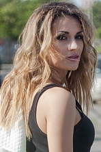 Ukrainian girl Alla,32 years old with brown eyes and light brown hair.