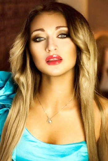 Ukrainian girl Elena,30 years old with blue eyes and light brown hair.