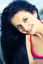 Ukrainian girl Nadejda,26 years old with green eyes and black hair.