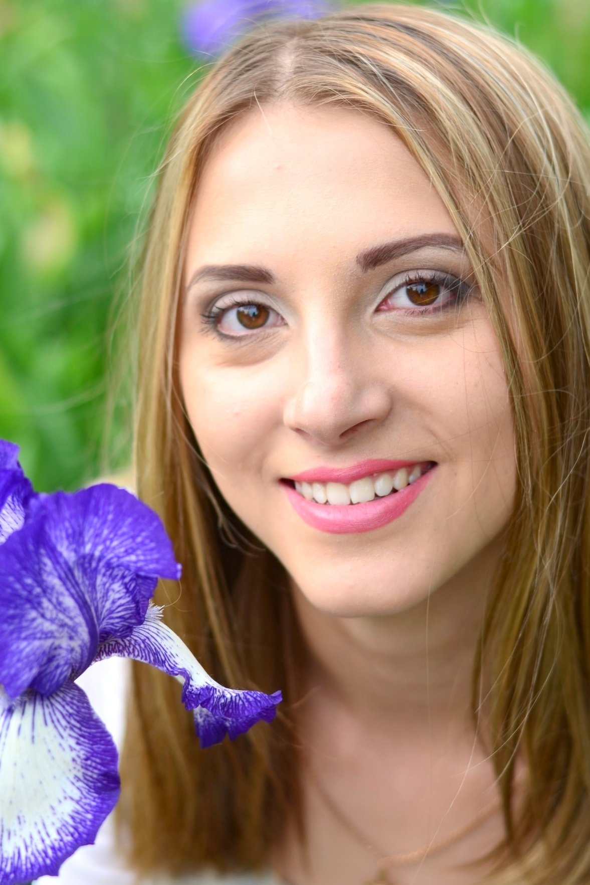 Ukrainian girl Olga,22 years old with brown eyes and light brown hair.