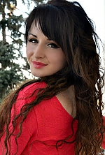 Ukrainian girl Nina,25 years old with green eyes and black hair.