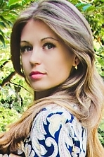 Ukrainian girl Anastasia,24 years old with blue eyes and white grey hair.