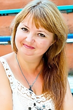 Ukrainian girl Elena,40 years old with hazel eyes and light brown hair.