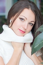 Ukrainian girl Lyudmila,28 years old with grey eyes and dark brown hair.