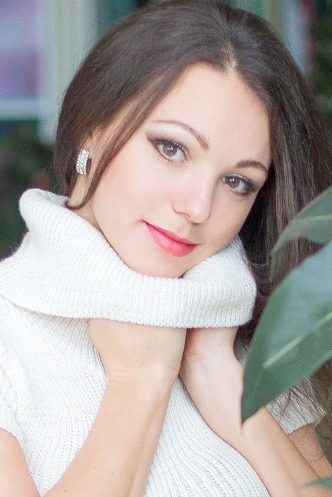 girl Lyudmila, years old with  eyes and  hair.