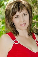 Ukrainian girl Elena,41 years old with hazel eyes and dark brown hair.