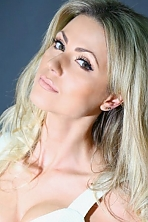 Ukrainian girl Irina-Luiza,33 years old with green eyes and blonde hair.