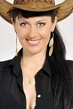 Ukrainian girl Elena,41 years old with green eyes and dark brown hair.