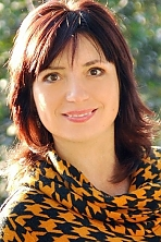 Ukrainian girl Lilia,41 years old with brown eyes and dark brown hair.