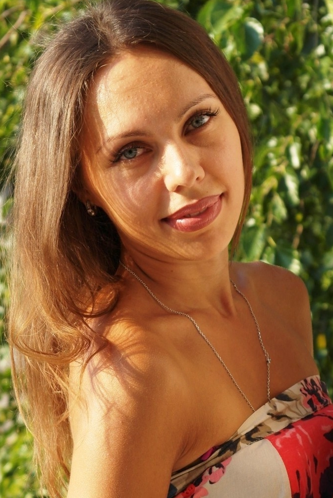 Ukrainian girl Anastasiya,31 years old with blue eyes and dark brown hair.