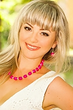 Ukrainian girl Lubov,33 years old with brown eyes and blonde hair.