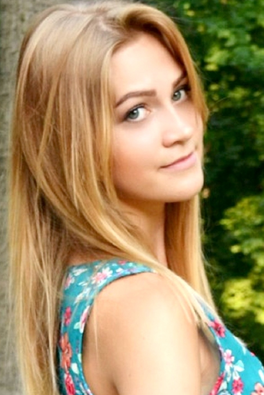 girl Kseniya, years old with  eyes and  hair.