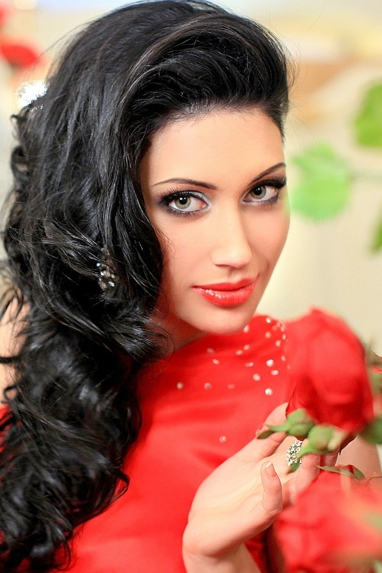 Ukrainian girl Nadegda,24 years old with green eyes and dark brown hair.