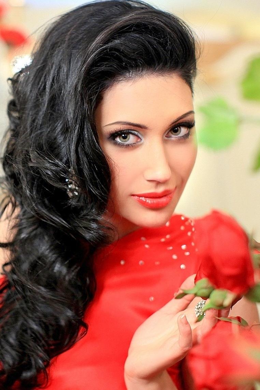 Ukrainian girl Nadegda,23 years old with green eyes and dark brown hair.
