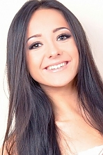 Ukrainian girl Snezhana ,23 years old with hazel eyes and black hair.
