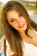 Ukrainian girl Kristina,27 years old with green eyes and light brown hair.