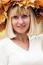 Ukrainian girl Natalia,32 years old with green eyes and blonde hair.