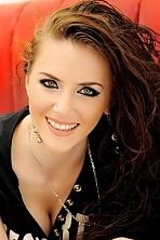 Ukrainian girl Jana,24 years old with grey eyes and light brown hair.
