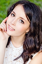 Ukrainian girl Nataliya,22 years old with hazel eyes and black hair.