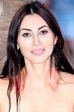 Ukrainian girl Olga,43 years old with brown eyes and dark brown hair.