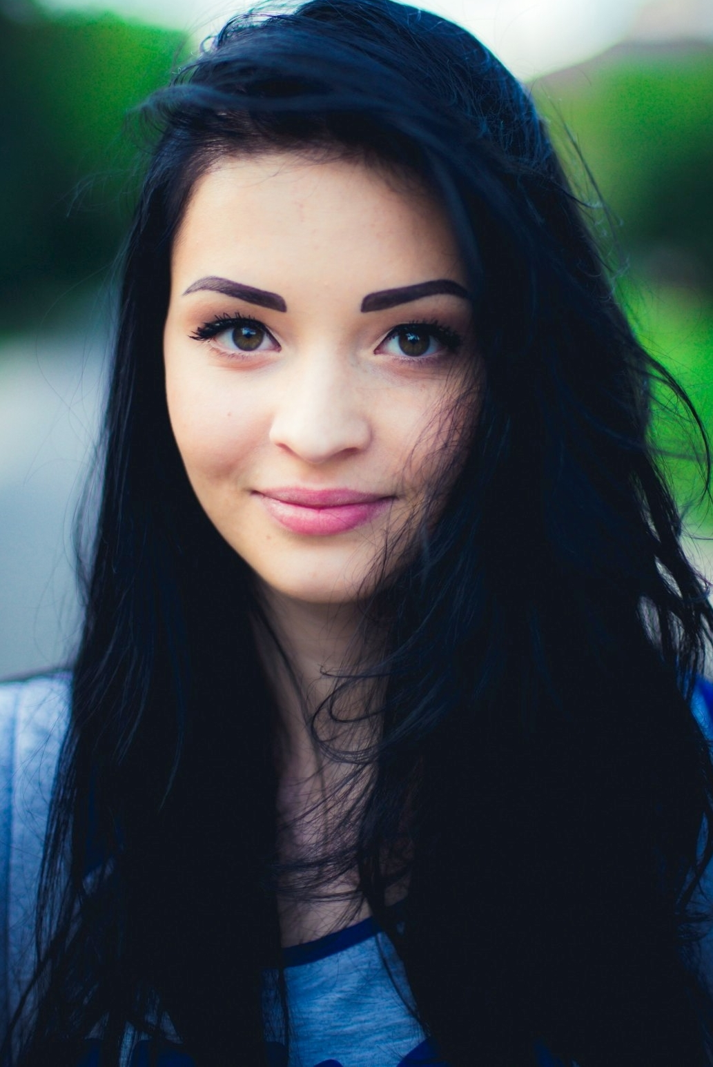 Ukrainian girl Olechka,24 years old with green eyes and black hair.