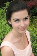Ukrainian girl Anastasiya,20 years old with blue eyes and black hair.