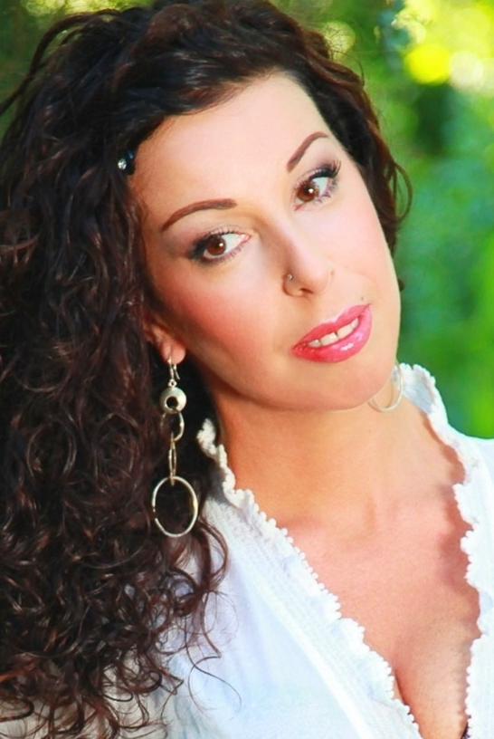 Ukrainian girl Viktoria,42 years old with brown eyes and dark brown hair.