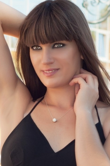 Ukrainian girl Victoria,34 years old with green eyes and dark brown hair.