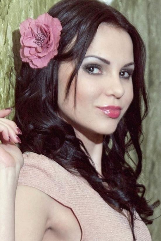 Ukrainian girl Kate,25 years old with hazel eyes and black hair.