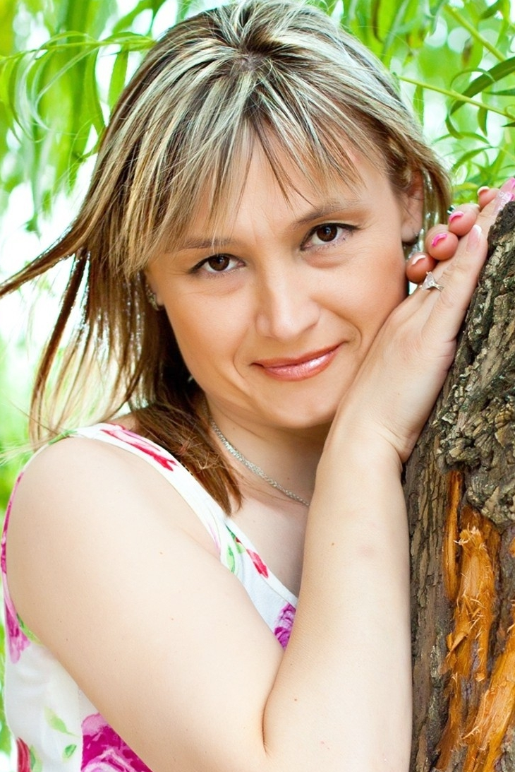 Ukrainian girl Marina,42 years old with brown eyes and blonde hair.