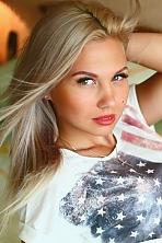 Ukrainian girl Evgeniya,24 years old with green eyes and blonde hair.