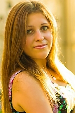 Ukrainian girl Svetlana,21 years old with green eyes and light brown hair.