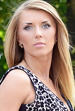 Ukrainian girl Viktoriya,31 years old with grey eyes and blonde hair.