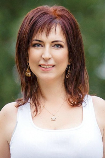 Ukrainian girl Victoria,47 years old with blue eyes and dark brown hair.