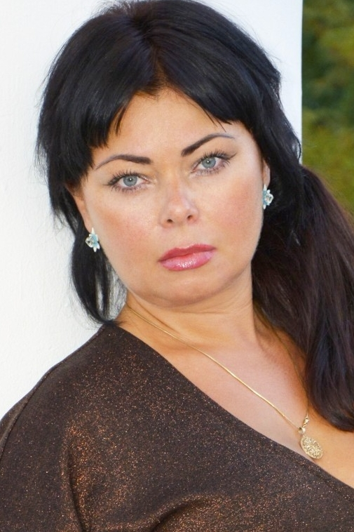 Ukrainian girl Lyudmila,39 years old with brown eyes and black hair.