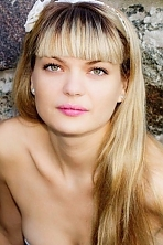 Ukrainian girl Lyudmila,32 years old with grey eyes and blonde hair.