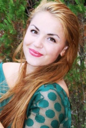 Ukrainian girl Julya,23 years old with green eyes and dark brown hair.
