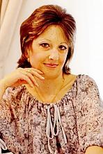 Ukrainian girl Tatyana,40 years old with grey eyes and light brown hair.