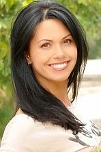 Ukrainian girl Irina,37 years old with brown eyes and black hair.