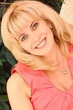 Ukrainian girl Larisa,46 years old with grey eyes and blonde hair.