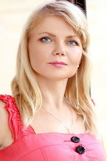 Ukrainian girl Svetlana,46 years old with green eyes and blonde hair.