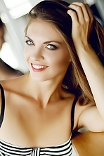Ukrainian girl Elizaveta,26 years old with green eyes and light brown hair.