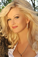 Ukrainian girl Liliya,34 years old with green eyes and blonde hair.