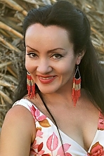 Ukrainian girl Katerina,42 years old with brown eyes and black hair.