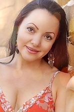 Ukrainian girl Ludmila,43 years old with brown eyes and black hair.