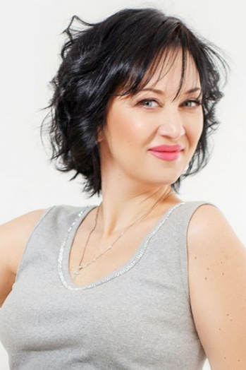 Ukrainian girl Svetlana,47 years old with blue eyes and dark brown hair.