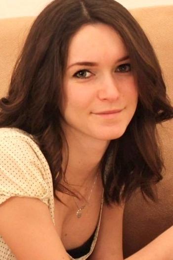 Ukrainian girl Ekaterina,23 years old with green eyes and dark brown hair.