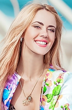 Ukrainian girl Evgeniya,27 years old with grey eyes and blonde hair.